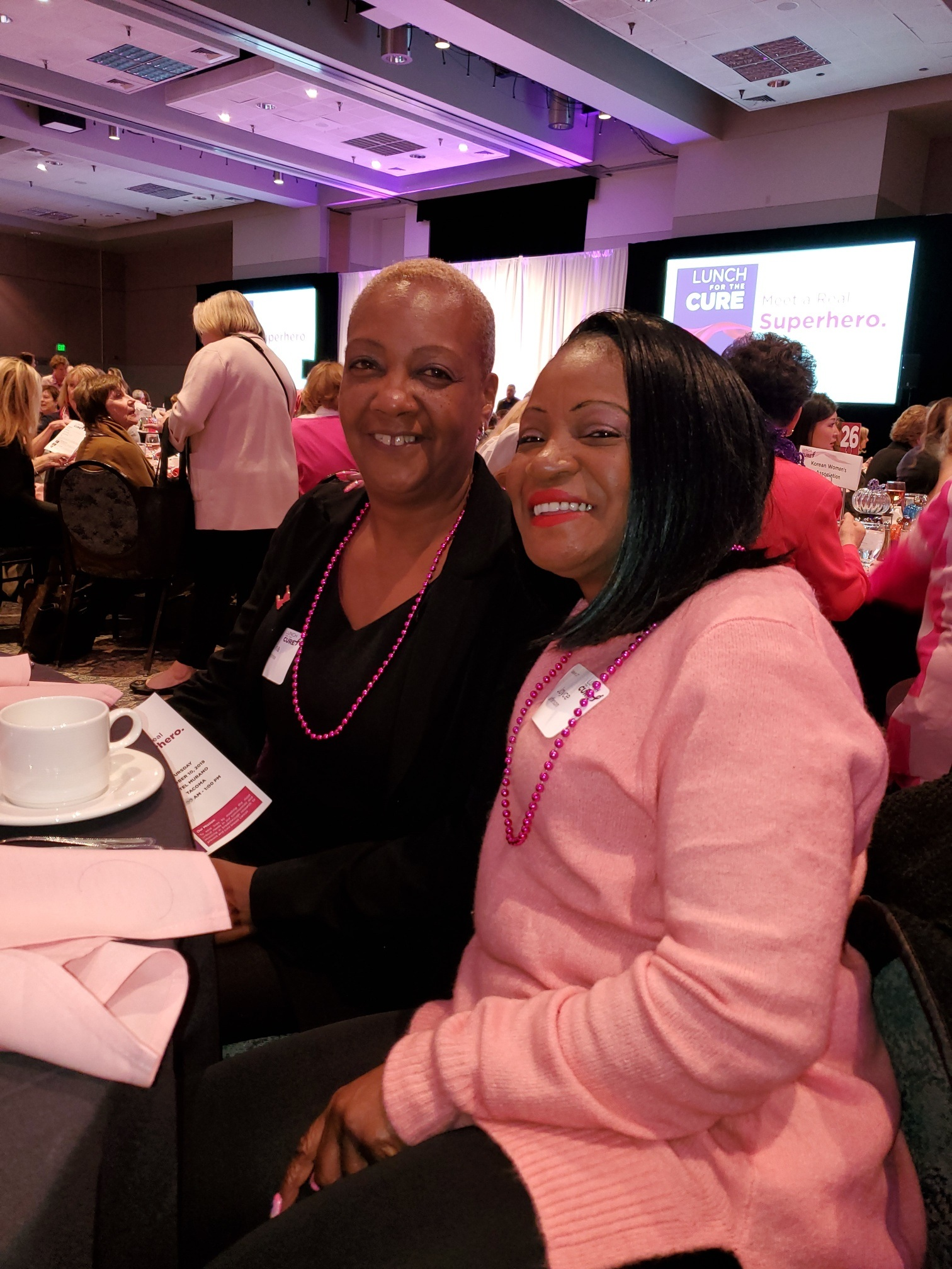 Joyce Jefferson (R) w client Tina White (L) at Cure for Cancer Event